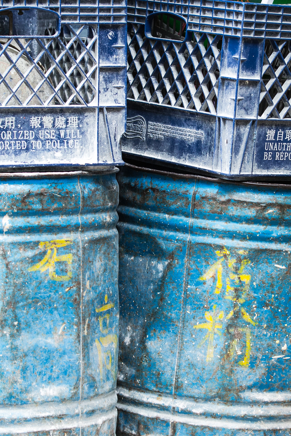 blue containers with yellow caracters